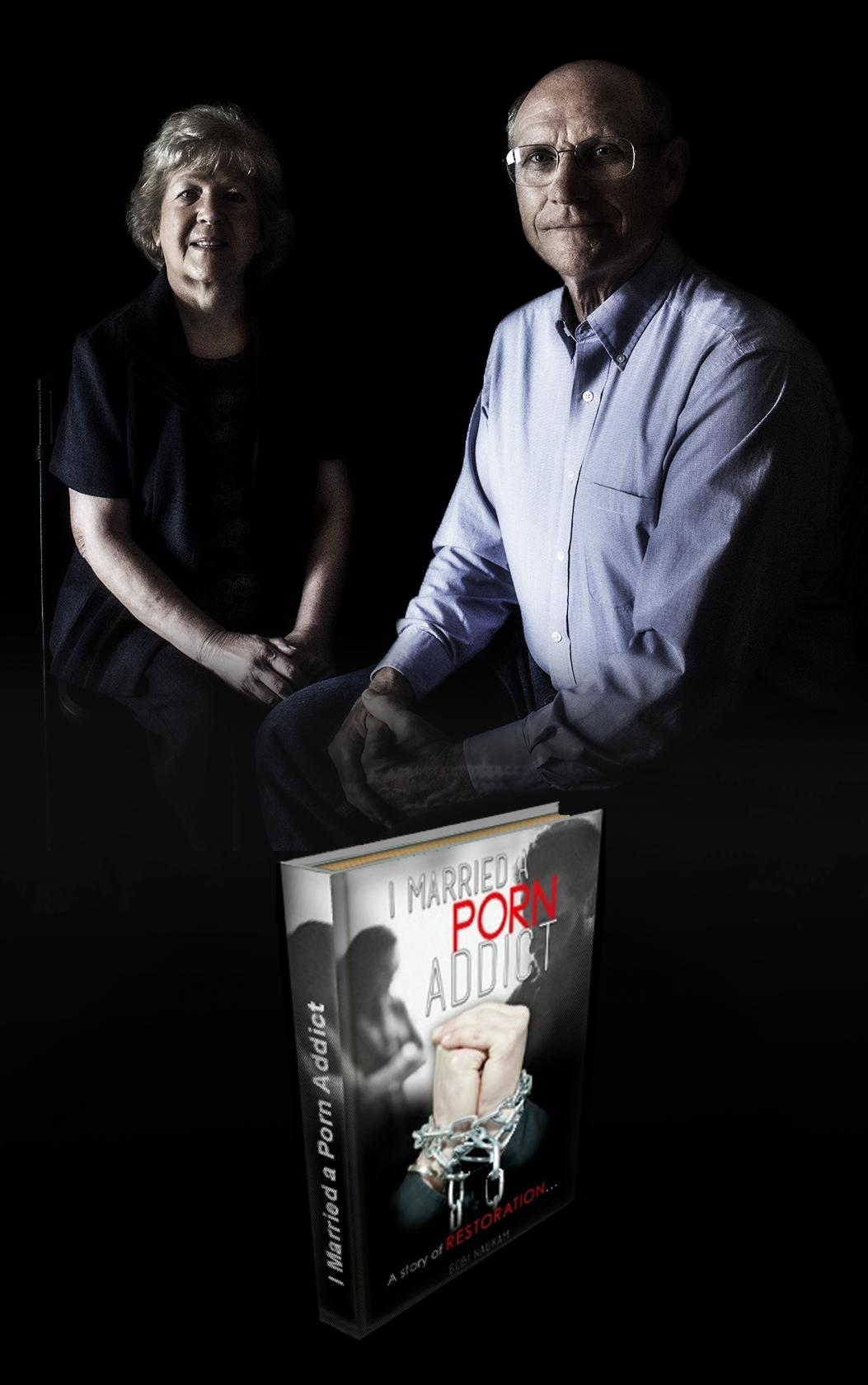 Phil Bobi Naukam sitting with book